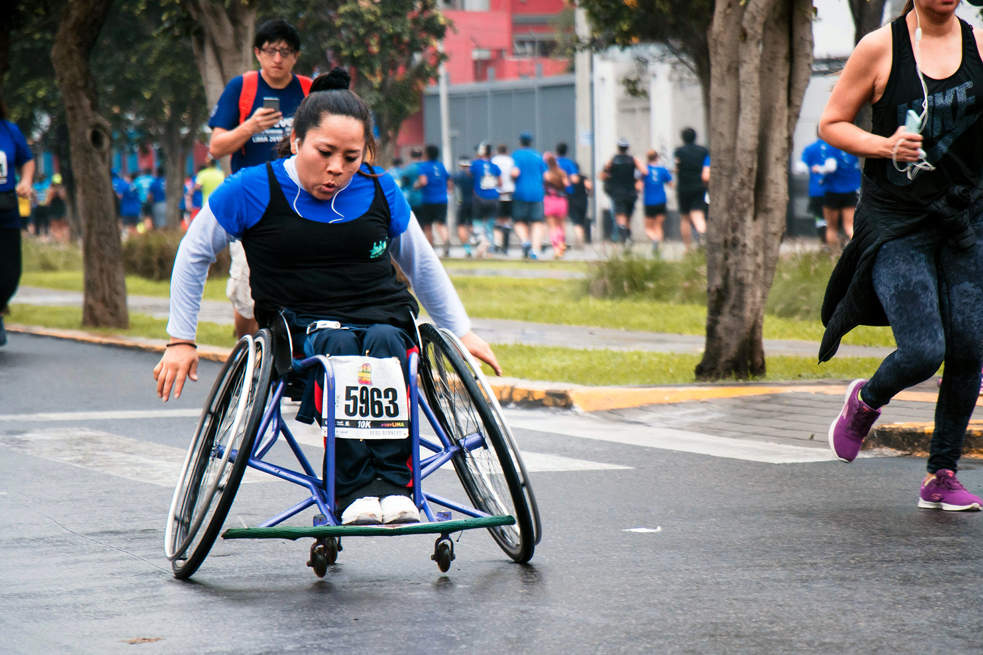 Woman racing in wheelchair.